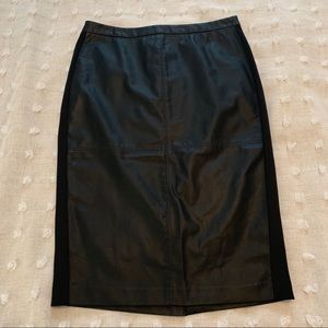 The limited black pencil skirt size 8